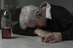 Senior man sleeping after drinking too much alcohol ** Note: Visible grain at 100%, best at smaller sizes